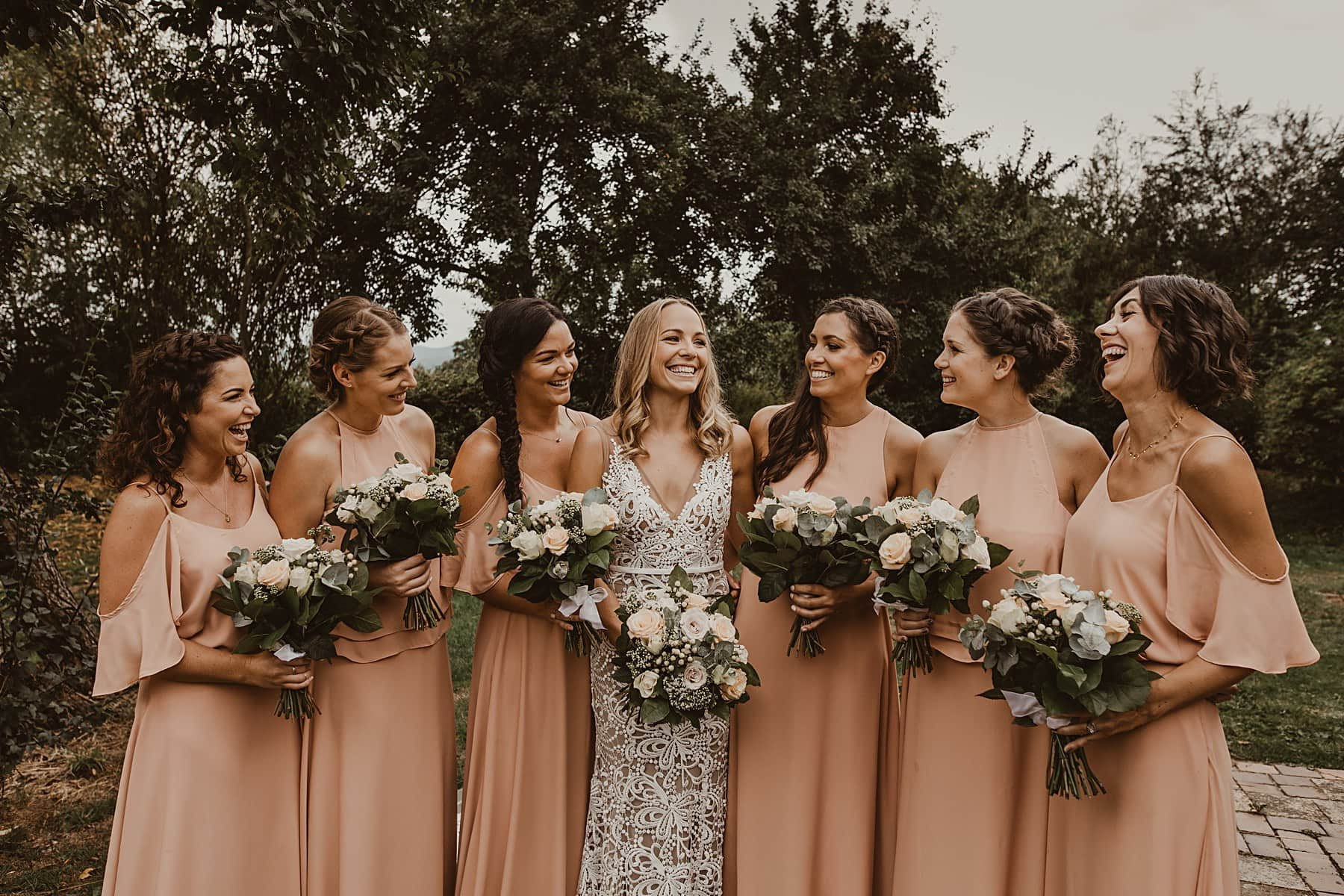 Bridesmaids laughing, rewritten dresses