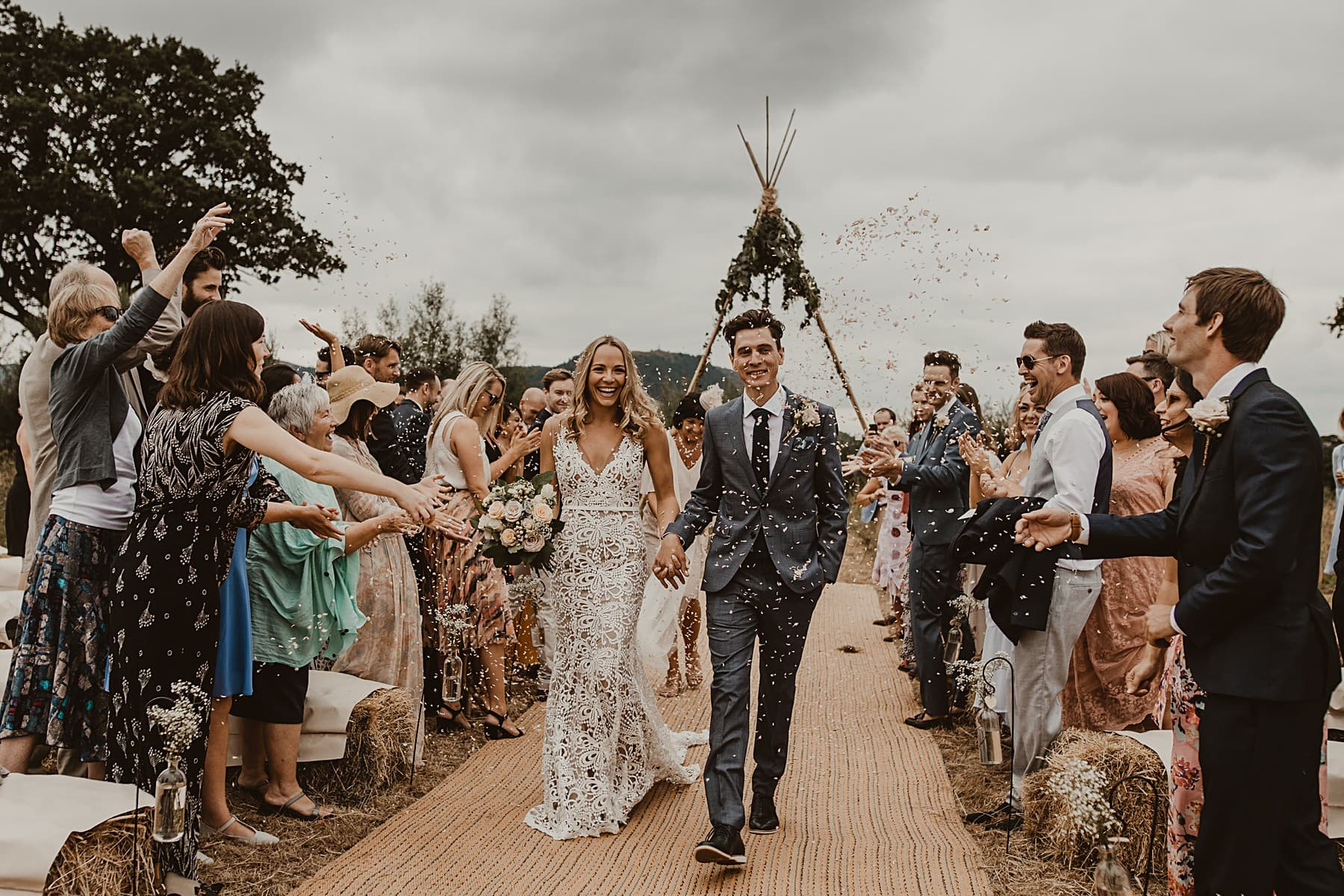 Confetti shot rustic wedding, naked tipi